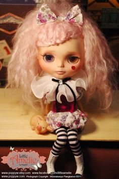 The Circus Collection : Lovely clown dress set for Blythe  I'm very proud to present this lovely set for you. Coz' it is very cute and cool! When I started to made the Circus Collection, I was fun and happy to made them. Hope you guys like my work, too.  •The balloon dress made from Liberty of London fabric and real Thai Silk. •The clown collar made from pleated chiffon fabric, decorated with black velvet ribbon and fake crystal knot. •The hair pin made from Liberty of London fabric (2011)