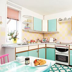 Kitchens: Vintage Kitchen with Blue Kitchen Cabinet also White Dining Table plus Colorful Dining Chairs and White Induction Stove