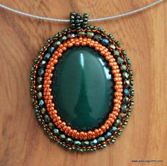Hand embroidered large dark green and orange beaded pendant with an agate cabochon von JessicaMGrimm auf Etsy