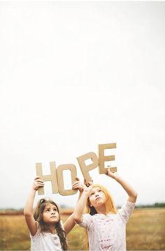 Hope ♥ Wouldn't it be great if we all could provide Help for today and Hope for tomorrow ♥ Be the change ♥ Anna Pociask Photography two young girls holding Hope photo
