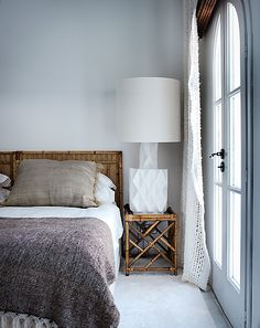 pinned by barefootblogin.com   Caroline Legrand Design. oversized white lamp, bambu and throw