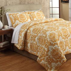 Offering resort-worthy style for your master suite, this cotton quilt set showcases a traditional floral damask motif in yellow.Produ...