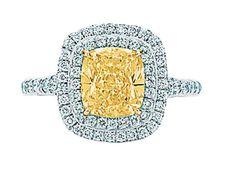 Fancy Yellow Diamond elongated Cushion Cut with a double 'halo'.