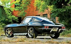 1963 Chevrolet Corvette Coupe Rear View - Wow! Fancy wheels and side pipes!