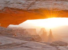 As a new year dawns across America's national parks, adventure awaits in Utah's high desert.  The above photo captured a recent sunrise at Mesa Arch in Canyonlands National Park in Utah. The famous Washer Woman arch can be seen in the background.  Canyonlands is a wilderness of countless canyons and buttes carved by the Colorado River and its tributaries. Rivers divide the park into four districts, with names that beckon outdoor enthusiasts: the Island in the Sky, the Needles, the Maze and…