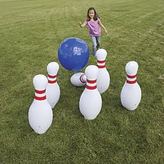 "Jumbo Inflatable Bowling Set: Roll it, throw it, kick it…our giant inflatable bowling set takes the sport to a whole new level! Its a great way to get kids moving—kids bowl using their whole bodies—and a guaranteed hit at parties. And dont be surprised when the grownups join in. Set includes 21"" bowling ball (complete with three giant finger holes) and six 27""H bowling pins, with flat bases..."