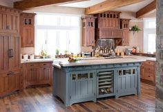 dark rustic cabinets with green/gray island