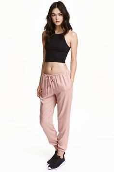Joggers: Trousers in a soft viscose weave with an elasticated drawstring waist, side pockets and wide, gently tapered legs with elasticated hems.