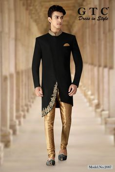 A perfect example of grace and style, Get garbed with this GTC- Classic Sherwani  fabricated on imported-TR fabric enriched with pure handbeaded work on mandarin collar neckline and on the assymetrical cut, whereas elegant buttons complete the look of front panel. It is paired with gold chudidar. Design, Colour Scheme customizations are available Indian Marriage Dress, Wedding Dresses Men Indian, Wedding Dress Men, Wedding Wear, Indian Men Fashion, Mens Fashion, Grey Slim Fit Suit, Mens Kurta Designs, Bollywood Outfits