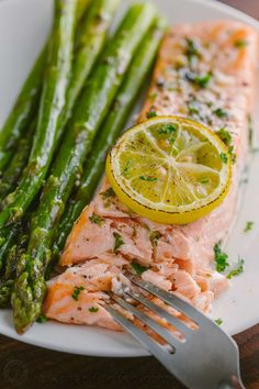One-Pan Salmon Asparagus recipe with a lemon-garlic-herb butter. Every bite is so juicy and flavorful! A reader favorite, salmon dinner. Salmon Recipes, Fish Recipes, Seafood Recipes, Dinner Recipes, Cooking Recipes, Healthy Recipes, Healthy Treats, Healthy Life, Recipies