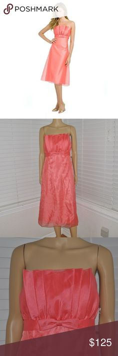 Tea-length Strapless Organza Dress w/crumb catcher After Six Bridesmaid Dress  style # 6529 new with tags size: 8 color: coral (pink)  Tea-length Strapless Organza Dress with crumb catcher neckline and bow at front empire waist. Organza Fabric. Strapless Neckline. Tea length. A-line. Bridesmaid Dress  @cjrose24  More formals in my posh closet. After Six Dresses Prom