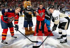 Jose Fernandez drops the ceremonial puck to Jussi Jokinen of the Florida Panthers and Sidney Crosby of the Pittsburgh Penguins prior to the start of a February 2016 game in Sunrise, Fla.   -   Marlins plan to unveil Jose Fernandez sculpture  -  April 13, 2017