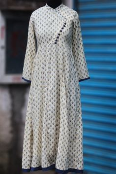 Buy Maati Crafts White Cotton Printed Angrakha Anarkali Kurti online in India at best price.a long traditional anarkali with cross button potlis in angrakha style, inspired by mughal folklore. Indian Gowns, Indian Wear, Indian Outfits, Indian Clothes, Kurti Patterns, Dress Patterns, Angrakha Style, Churidar Designs, Kurta Neck Design