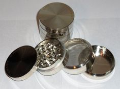 """SMART CRUSHER® Four Piece Aluminum 2 1/4"""" Herb, Spice or Tobacco Pollen Grinder ..VALUE PRICED by Smart-Goods. $11.99"""