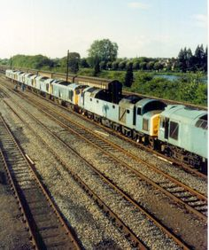 Stored diesel locomotives in Hinksey yard on the way for scrap In the photo are Class number 97202 (formerly Class 40 number Class 25 numbers 25075 and 25027 ---- England Electric Locomotive, Diesel Locomotive, Steam Locomotive, Abandoned Train, Abandoned Places, Uk Rail, Train Room, Old Trains, British Rail