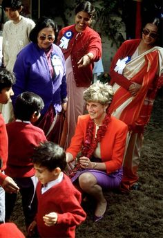 Princess Diana talks to children at the Marie Stopes centre in Agra, India, February 11, 1992.