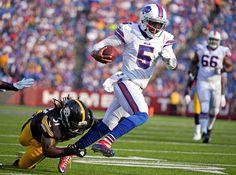 Buffalo Bills quarterback Tyrod Taylor (5) gets past Pittsburgh Steelers inside linebacker Sean Spen... - Gary Wiepert/AP Photo