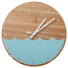 Bring a coastal feel into your home with this wave themed wooden clock. With a natural raw wooden face and printed blue wave theme, you can easily mount on any flat surface using the attached mounting hook.
