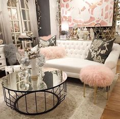Beautiful pink, white, grey decor.  The fur seats are just too cute! The white sofa balances everything out.