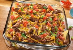 SHREDDED BEEF NACHOS GRANDE - Tortilla chips are topped with shredded beef, pinto beans and Cheddar cheese for tasty nachos everyone will enjoy. Plus, you can have this easy appetizer ready to serve in just 25 minutes. Easy Appetizer Recipes, Healthy Recipes, Mexican Food Recipes, Mexican Dishes, Fall Appetizers, Spanish Recipes, Delicious Recipes, Slow Cooker Recipes, Beef Recipes