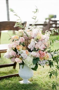 Large flower arrangements at the altar (included in ceremony package)