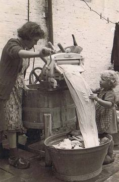 ♥ Very old wooden wringer washing machine. At some stage I bet some woman was delighted to get one of these!