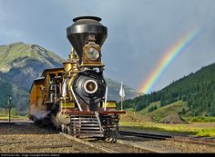RailPictures.Net Photo: EP 4 Eureka and Palisade Steam 4-4-0 at Silverton, Colorado by Kevin Madore. The Omen. Day 2 of the Durango & Silverton's annual Railfest dawned mostly cloudy and the weather just went downhill from there.  Then suddenly, around 6:15 PM, a sliver of clear sky began to appear to the west. Like magic, a rainbow formed in the mist over the hills and began to grow and deepen in color.