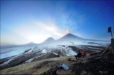 Majestic view on 3 big Kamchatka volcanos.