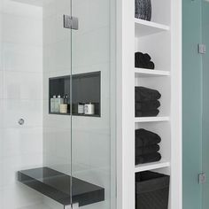 Built-in storage, tons of shower space, and a Jet Black shower bench - be still our hearts! Jodie Rosen Design certainly makes an impact with this black and white bathroom oasis. Bathroom Towel Storage, Shower Storage, Bathroom Organization, Kitchen Storage, White Bathroom, Bathroom Interior, Bathroom Ideas, Master Bathroom, Garage Bathroom