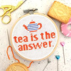 """Is tea the answer to your daily dilemmas? This modern cross stitch craft kit is perfect for tea lovers! This kit uses a midi sized 4"""" wooden embroidery hoop and full and simple instructions to cross stitch the Tea is the Answer slogan in a vibrant orange colour. The orange perfectly compliments the cute cornishware inspired teapot design in blue and white. The finished cross stitch can be hung up on the wall or propped on a shelf with your lovely vintage teaware - perfect for kitchen…"""