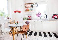 The colorful Swedish home of Johana from Aprill Aprill. The placement of the black and white kitchen rug transforms the floor into a piano keyboard. Kitchen Rug, Kitchen Interior, Skandi Kitchen, Nice Kitchen, Kitchen Chairs, Kitchen Ideas, Decoration Inspiration, Design Inspiration, Decor Ideas
