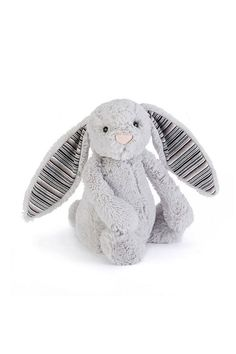 Bashful Blake Bunny is one cool guy! With his warm, grey fur, he's a little stormcloud, ready to bounce across the sky! But peek underneath those long lop ears and there's a further surprise in store - so many splendid, striking stripes in black and grey and red! Tested to and passes the European Safety Standard for toys. Hand wash only.    Height: 18cm   Blake Bunny Toy by Pink Poodle Boutique. Home & Gifts - Gifts - Gifts by Occasion - Baby & Kids Glasgow, Scotland, United Kingdom