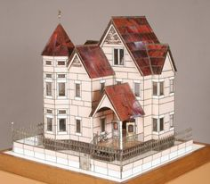 This is so cool! A dollhouse and furniture made entirely of stained glass! Imagine it in full sunlight...