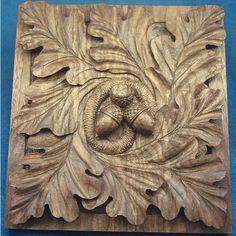 carved oak leaves and acorns