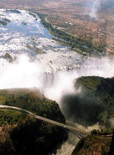 Victoria Falls, Zimbabwe.  Bungee jumping from the bridge anyone?