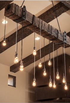 Bulbs on cords swung over a beam. Simple and effective.