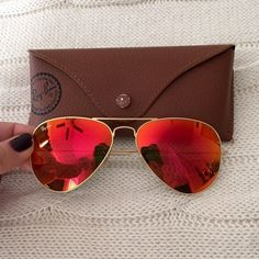 Ray-Ban Mirrored Aviators Orange mirrored aviators by Ray Ban with gold frame. These sunglasses are in absolutely perfect condition. They have these in 2 sizes, this is the smaller one. It comes with original case. I paid $170 plus tax for these Ray-Ban Accessories Sunglasses