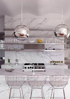 marble and stainless steel color scheme. Unique spherical pendant lights.