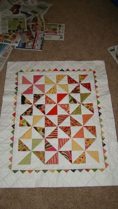 Piece N Quilt: cute pinwheels baby quilt from charm squares.