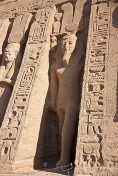 Abu Simbel the statue of Ramses next to his Queen Neretari