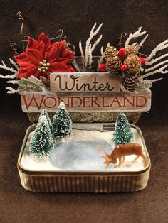 This Christmas keepsake decoration is made from a recycled Altoids tin. Its meant to sit open and was designed to not close. The pond/ice skating rink