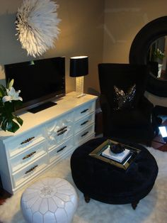 For the Love of Black - Chic living room with white vintage media cabinet, TV, white ... I want this for my office at home