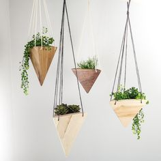 These Geometric Hanging Wooden Planters by Fernweh Woodworking are handmade in Bend Oregon.