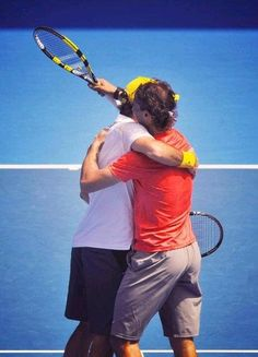 Roger Federer and Rafa after a charity relief match.