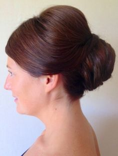 Elegant classic style with a mid height layered swirl detail creating a bun, hair pieces were used to thicken the shape -Hair by Jac