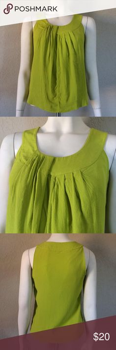 Kate Spade Tank Green Tank Top Size Xs Kate Spade Tank Green Tank Top Size XS Live colorfully with this Kate Spade Tank. This green is a gorgeous chartruese and is in great condition; no stains, wear, or holes. This tank is lined to protect the outer layer from any sweat stains. I love this tank! kate spade Tops Tank Tops