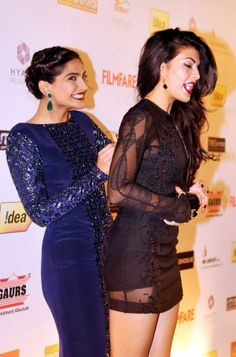 """Indian Bollywood actresses Sonam Kapoor (L) and Jacqueline Fernandez share a light moment while they pose for a photograph during the """"Idea Filmfare Awards Bollywood Actress Hot Photos, Indian Bollywood Actress, Beautiful Bollywood Actress, Most Beautiful Indian Actress, Bollywood Fashion, Bollywood Bikini, Bollywood Gossip, Bollywood Stars, Bollywood News"""