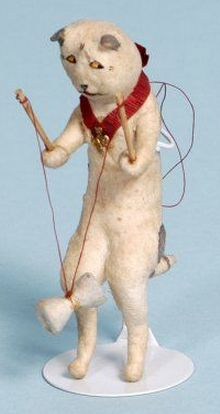 Cat playing with a diabolo. Spun cotton Christmas tree ornament.