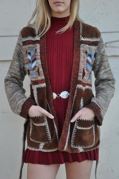 DescriptionWhat a beauty this sweater is. It features soft and buttery cowhide leather insets with acrylic, gorgeous stitching, a big set of pockets, a belt, be Geek Chic Fashion, Norwegian Wood, Rust, Cinnamon, Coats, My Style, Sweaters, Jackets, Collection