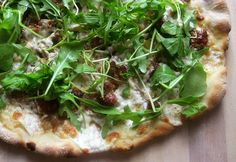 pizza 13 by pete bakes, via Flickr.         Prime rib leftovers and arugula pizza!